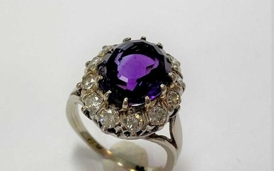 An amethyst and diamond oval cluster ring