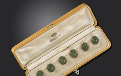 An early 20th century set of six carved nephrite scarab buttons by Fabergé, realistically formed oval scarabs set in gold with a surround of rose-cut diamonds, scratched inventory number 23824, the gold loops stamped 56 and most with initials ÊÔ (some...
