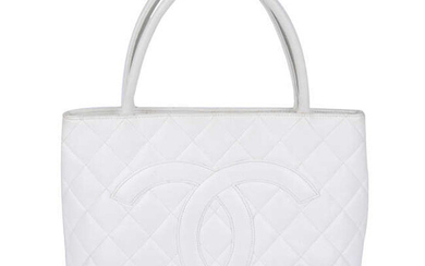 CHANEL - a white quilted Caviar Medallion Tote.