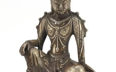 Chinese silver coloured metal figure of a deity, 23.5cm
