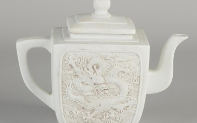 Chinese white porcelain teapot with relief dragon