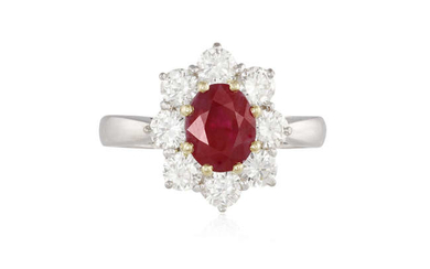 Description A RUBY AND DIAMOND CLUSTER RING The oval-shaped...