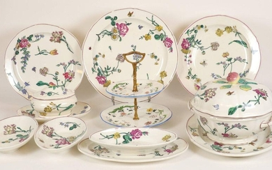 Gien earthenware dinner service part comprising: 1 tureen, 3 round dishes, 2 oval dishes, 3 bowls, 1 sauce boat and 1 display stand