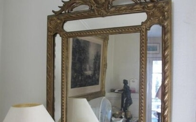 Gold lacquered wood glazed mirror, the pediment decorated with a cartouche.