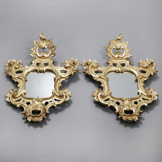 Pair of Rococo style ornamental mirrors in carved and gilt wood, 19th Century.