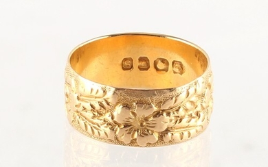 Property of a lady - an 18ct gold fancy band ring, size N/O,...