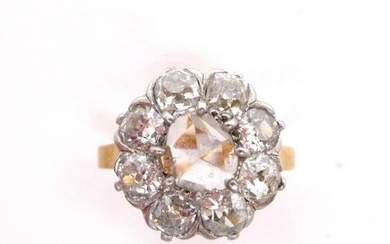 RING in 18K yellow gold and platinum with a flower holding a rose cut diamond in the center in a ring of old cut diamonds. TDD: 52. Gross weight : 4.56 gr. A diamond, platinium and gold ring.