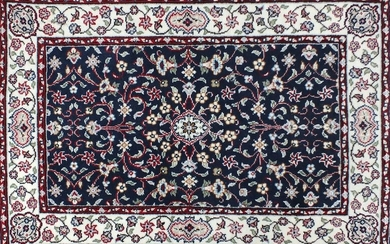 Rectangular persian rug having an all over floral