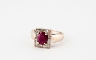 Rhodium-plated yellow gold (750) ring with a rectangular bezel centered on an oval (treated) faceted ruby in claw setting in a ring of baguette-cut diamonds in rail setting.