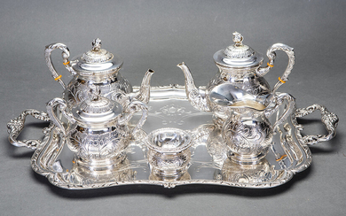 Set of coffee and tea in Spanish silver punched composed of: coffee pot, teapot, sugar bowl, vase and strainer with chiselled decoration of vegetable elements and flowers. On rectangular tray with handles with field engraved with the same decorative...