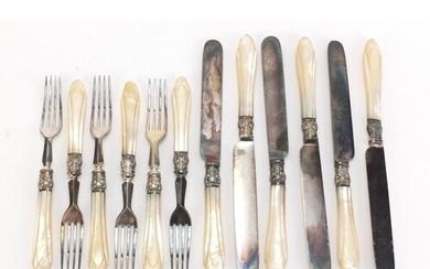 Set of six silver plated knives and forks with mother of pea...