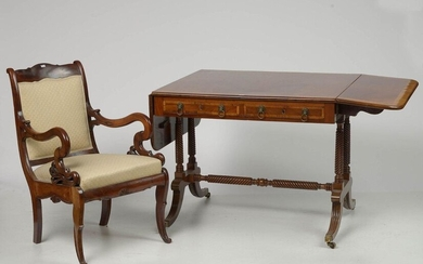 "Table with two flaps and its Sheraton style armchair in mahogany and light wood veneer opening by two drawers in belt. Handles in the shape of ""Lion's head"" in gilt bronze. Twisted ""H"" shaped frame on casters. British work. Period: 19th century. Size..."