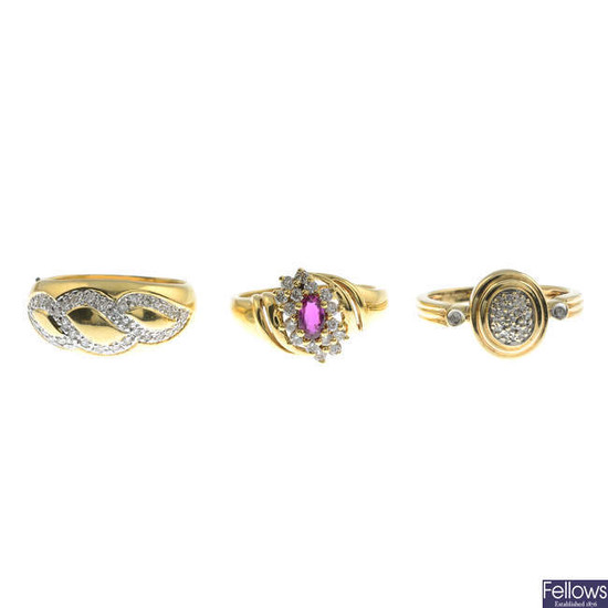 Three gold diamond and ruby rings.