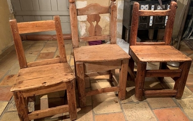 Three pine and larch chairs. Between the two...