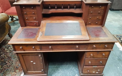 Victorian Mahogany Dicken's Style Desk, with gallery back and eight trinket drawers, burgundy writing surfaces & eight drawers below...