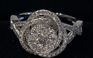 18CT WHITE GOLD DIAMOND CLUSTER RING in a swirling wave desi...