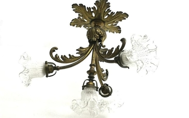 5-Four-light ceiling light, gold plated metal. Decorated with...