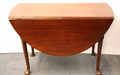 A 1920's oval mahogany dropleaf dining table, W. 108cm.