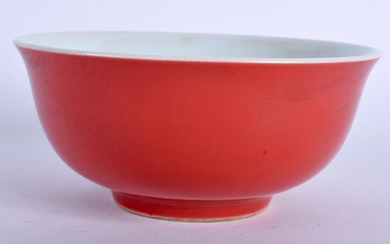 A 20TH CENTURY CHINESE RED GLAZED BOWL, formed with a