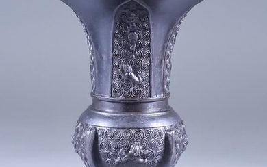 A Chinese Bronze Flared Vase of Archaic Form, moulded...