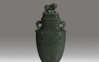 A Chinese carved sage-green jade vase and cover Of...