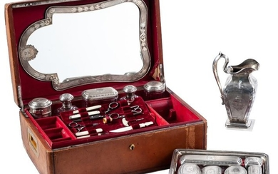 A French silver vanity set with engraved initials,...
