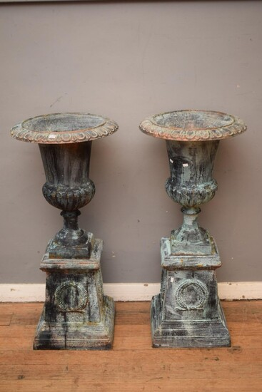 A PAIR OF CAST IRON URNS (106H X 47DIMAMETER CM) (PLEASE NOTE THIS HEAVY ITEM MUST BE REMOVED BY CARRIERS AT THE CUSTOMER'S EXPENSE...