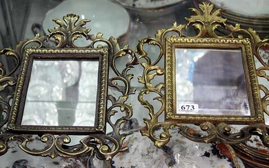 A PAIR OF LATE VICTORIAN BRASS MIRRORS