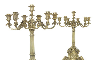 A PAIR OF VICTORIAN SILVER-GILT SEVEN-LIGHT CANDELABRA, MARK OF ROBERT GARRARD, LONDON, 1865