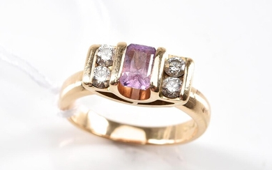 A PINK SAPPHIRE AND DIAMOND RING - Centrally set with a sapphire flanked by four diamonds in 18ct gold, size K, 7.3gms.
