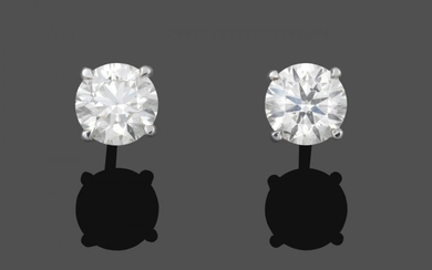 A Pair of 18 Carat White Gold Diamond Solitaire Earrings,...