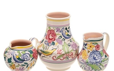 A Poole Pottery vase and jug and a further jug: decorated af...