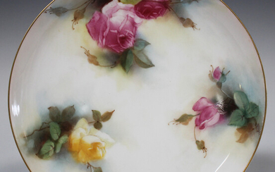 A Royal Worcester plate, circa 1913, painted by K.H. Blake, signed, with pink and yellow roses in bu