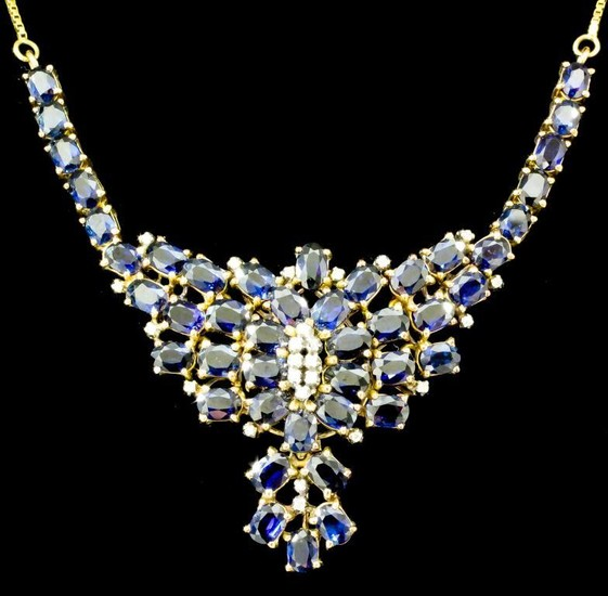 A Sapphire and Diamond Pendant, Modern, in 14ct gold...