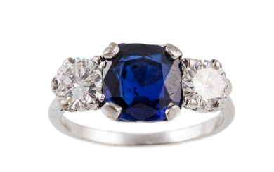 A THREE STONE SAPPHIRE AND DIAMOND RING, mounted in platinum
