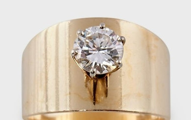 A diamond and fourteen karat gold ring
