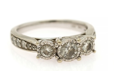 A diamond ring set with a brilliant-cut diamond weighing app. 0.28 ct. flanked by two brilliant-cut diamonds, mounted in 14k white gold. Size 55.