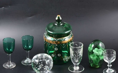 A green glass paperweight and one other, two green stemmed glasses