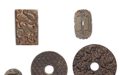 A group of three archaistic Chinese stone bi discs and two pendants.