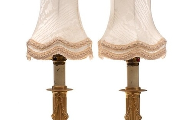A pair of 19th Century gilt metal table lamps: with fluted a...