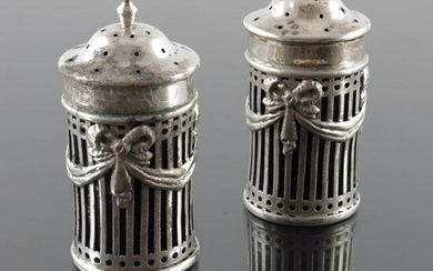 A pair of Edwardian silver salt and pepper shakers