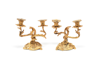 A pair of gilt bronze twin light dwarf candelabra