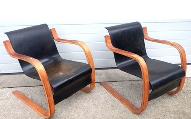 A pair of mid-century bent plywood cantilever arm chairs in ...