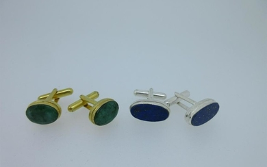 A pair of single ended emerald cufflinks and a similar