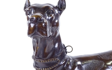 A patinated bronze standing dog, signed on the tail, height ...