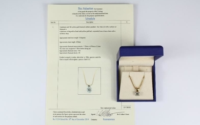 A platinum and 18ct yellow gold diamond solitaire pendant....