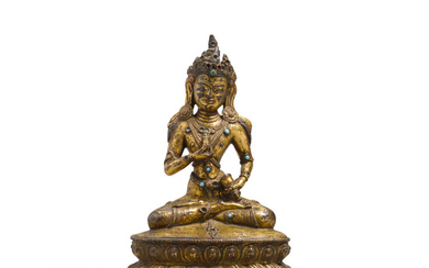 A seated gilt metal alloy figure of Vajrasattva