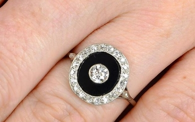 An Art Deco onyx and old-cut diamond cluster ring.
