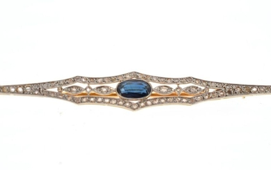 Barrette brooch in 18 K (750 °/°°°) yellow and white gold decorated with rose-cut diamonds and an oval sapphire in the centre
