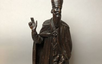 Bishop in carved and patinated natural wood. H....